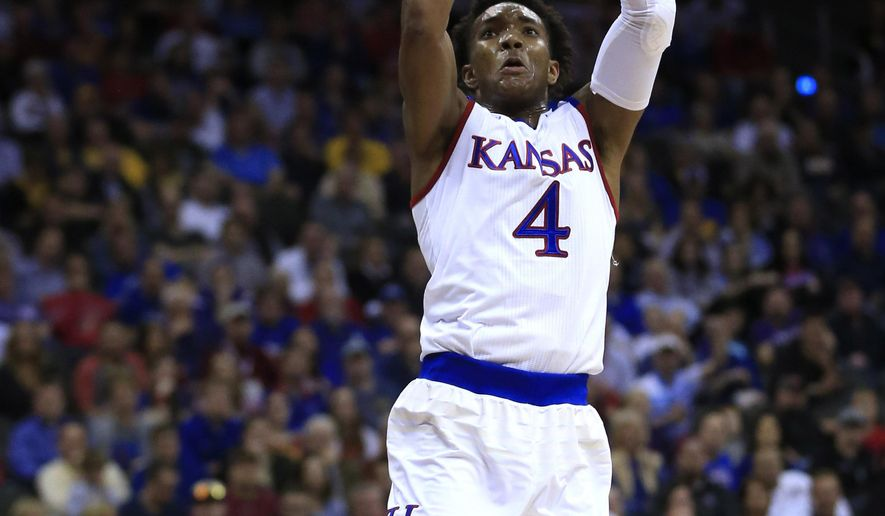 Kansas guard Devonte' Graham (4) dunks during the first half of an NCAA college basketball game against Baylor in the semifinals of the Big 12 Conference tournament in Kansas City, Mo., Friday, March 11, 2016. (AP Photo/Orlin Wagner)