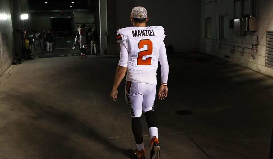 FILE - In this Nov. 5, 2015, file photo, Cleveland Browns quarterback Johnny Manziel walks off the field after an 31-10 loss to the Cincinnati Bengals, in Cincinnati. The Browns have released troublesome quarterback Johnny Manziel. The team cut ties on Friday, March 11, 2016,  with the 2012 Heisman Trophy winner after two disappointing, drama-filled seasons. (AP Photo/Frank Victores, File)