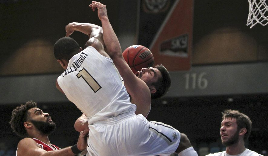 Idaho guard Perrion Callandret (1) and Eastern Washington forward Venky Jois collide during the first half of an NCAA college basketball game in the Big Sky Conference men's tournament in Reno, Nev., Thursday, March 10, 2016. (AP Photo/Lance Iversen)