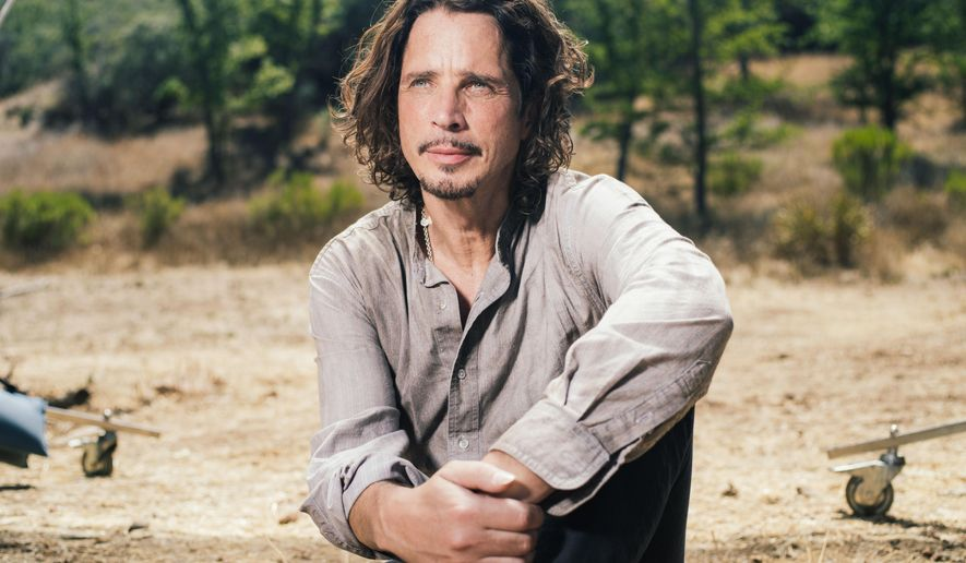 "In this July 29, 2015 file photo, Chris Cornell poses for a portrait to promote his latest album, ""Higher Truth,"" during a music video shoot in Agoura Hills, Calif. (Photo by Casey Curry/Invision/AP, File)"