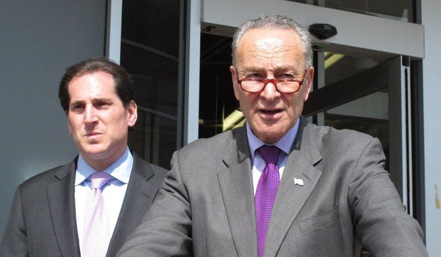 """U.S. Sen. Charles Schumer, right, speaks at a campaign event in Lawrence, N.Y., on Friday, March 11, 2016. Schumer says an alleged Iranian cyberattack on a damn in the suburbs north of New York City is a """"shot across the bow"""" of the United States. He is calling for tougher sanctions against Iran in response. At Schumer's right is Todd Kaminsky, a Democratic candidate for the New York state Senate. (AP Photo/Frank Eltman)"""