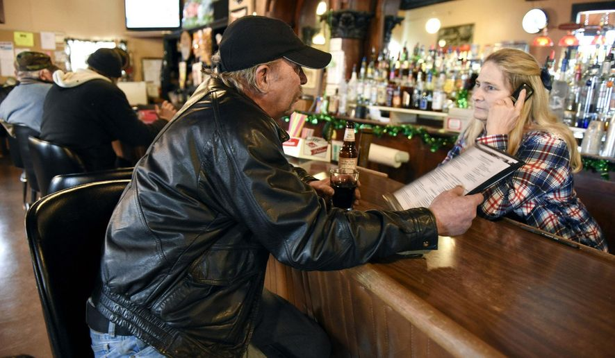 FOR RELEASE MONDAY, MARCH 14, 2016, AT 12:01 A.M. CST.  - Sandy Brutger, owner of The Lion's Den, orders lunch for Gary Harren, St. Anna, from the Cabin Cafe across the street Friday, March 4, 2016, in Avon, Minn. (Jason Wachter/St. Cloud Times via AP)