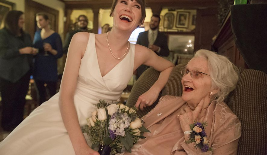 ADVANCE FOR SATURDAY, MARCH 12 AND THEREAFTER - In a Saturday, March 5, 2016 photo, Megan Pederson laughs with her grandmother Betty Kline after a surprise impromptu wedding at her parent's house in Des Moines.  The couple decided to bump up their wedding so that Megan's grandmother could be at the ceremony. (Rachel Mummey/The Des Moines Register via AP)  MAGS OUT, TV OUT, NO SALES, MANDATORY CREDIT