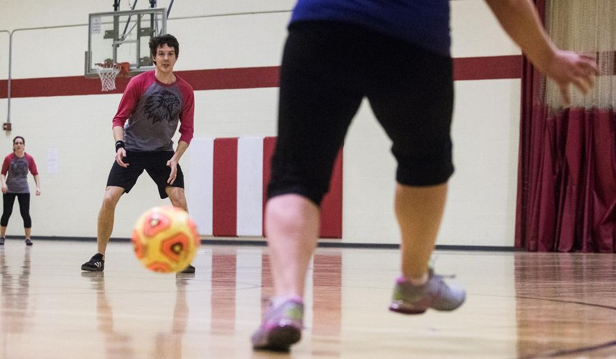 In this photo taken on Feb. 21, 2016, Steven Perkins pitches the ball during a kickball game, at Irving Recreational Center, in Lincoln, Neb. (Mischa Lopiano/The Journal-Star via AP) LOCAL TELEVISION OUT; KOLN-TV OUT; KGIN-TV OUT; KLKN-TV OUT; MANDATORY CREDIT