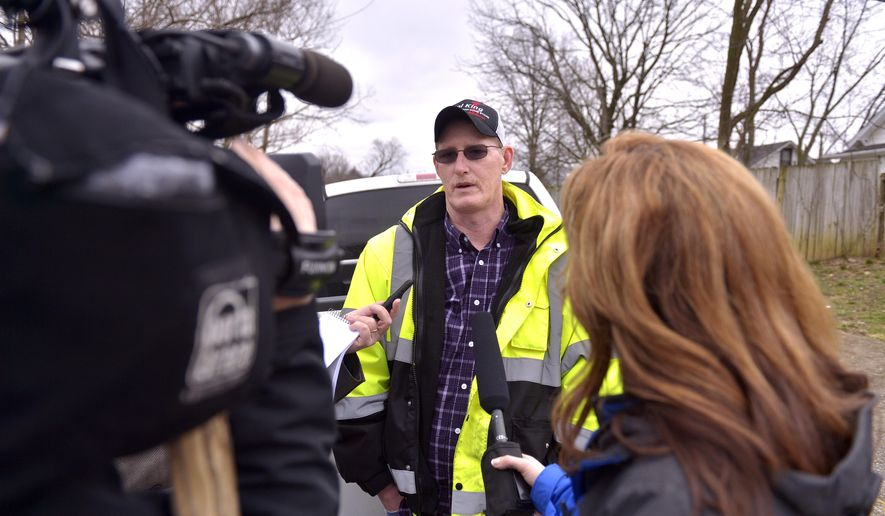 Keith Edwards, a resident of one of the apartments destroyed at the B&P Apartments, tells reporters how his dog 'Brat' alerted him to the fire, Friday, March 11, 2016 in Winchester Ky. A fire destroyed the apartment building in central Kentucky overnight, killing and injuring several people and forcing some residents to leap from second-story windows to escape. (AP Photo/Timothy D. Easley)
