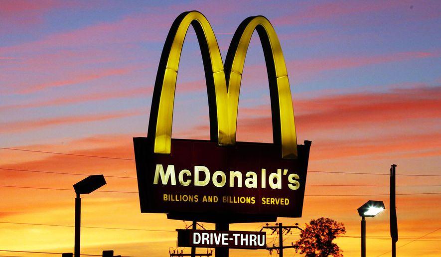 In this Oct. 10, 2015, file photo, the sun sets behind a McDonald's restaurant in Ebensburg, Pa. (AP Photo/Gene J. Puskar) ** FILE **
