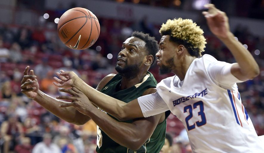 Colorado State's Tiel Daniels (15) and Boise State's James Webb III (23) vie for a rebound during the second half of an NCAA college basketball game at the Mountain West Conference men's tournament Thursday, March 10, 2016, in Las Vegas. Colorado State won 88-81. (AP Photo/David Becker)