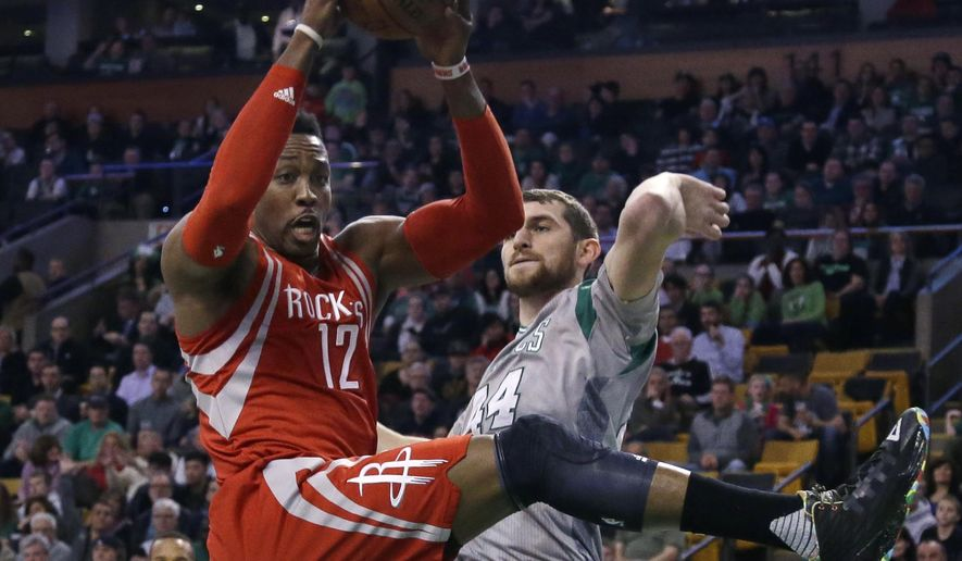 Houston Rockets center Dwight Howard (12) pulls down a defensive rebound against Boston Celtics center Tyler Zeller (44) in the first half of an NBA basketball game, Friday, March 11, 2016, in Boston. (AP Photo/Elise Amendola)