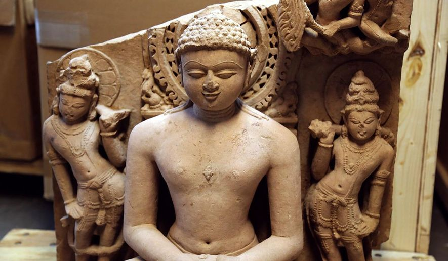 """In this photo provided by United States Immigration and Customs Enforcement, an Indian statue believed to be from the 8th and 10th centuries A.D. that authorities say was stolen and smuggled out of India is shown. The statue is one of two that were seized from Christies Auction House in New York on Friday, March 11, 2016. The antiquities were to be part of an auction on the week of March 14, entitled """"The Lahiri Collection: Indian and Himalayan Art, Ancient and Modern."""" Christie's said in a statement it was working with authorities and would never knowingly offer a stolen work of art. (United States Immigration and Customs Enforcement via AP)"""