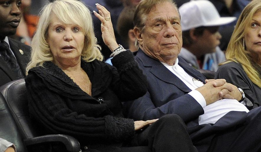 FILE - In this Nov. 12, 2010, file photo, Shelly Sterling sits with her husband, Donald Sterling, right, during the Los Angeles Clippers' NBA basketball game against the Detroit Pistons in Los Angeles. Former Los Angeles Clippers owner Donald Sterling and his wife Shelly Sterling have decided to stay in their six-decade marriage. (AP Photo/Mark J. Terrill, File)