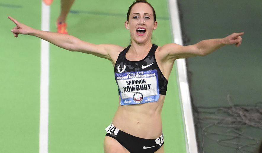 Shannon Rowbury celebrates after winning the women's 3,000 meters at the U.S. indoor track and field championships in Portland, Ore., Friday, March 11, 2016. (AP Photo/Steve Dykes)