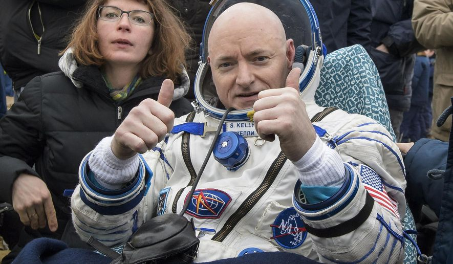 FILE - In this Wednesday, March 2, 2016 photo provided by NASA, International Space Station (ISS) crew member Scott Kelly of the U.S. reacts after landing near the town of Dzhezkazgan, Kazakhstan. On Friday, March 11, 2016, NASA announced Kelly's retirement, which begins April 1. The 52-year-old Kelly holds the American record for most time in space: 520 days. (Bill Ingalls/NASA via AP)