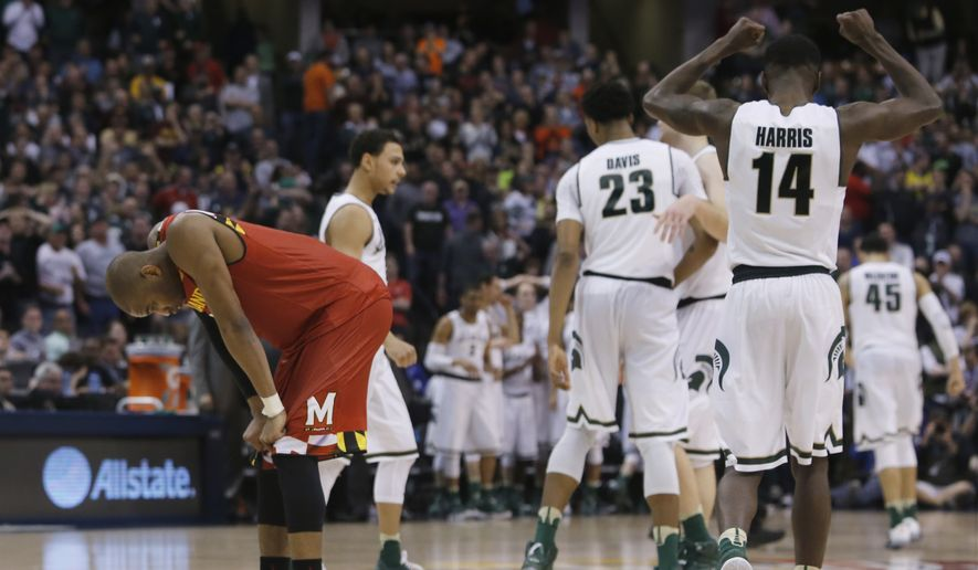 Maryland's Rasheed Sulaimon (0) looks down as Michigan State players celebrate after a Maryland foul in the final seconds of an NCAA college basketball game during the semifinals of the Big Ten Conference tournament in Indianapolis, Saturday, March 12, 2016. Michigan State defeat Maryland 64-61. (AP Photo/Kiichiro Sato)