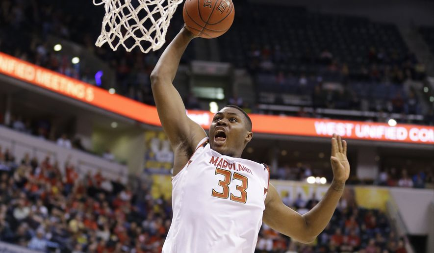 Maryland's Diamond Stone (33) goes up for a dunk during the first half of an NCAA college basketball game against Nebraska in the quarterfinals at the Big Ten Conference tournament, Friday, March 11, 2016, in Indianapolis. (AP Photo/Michael Conroy)