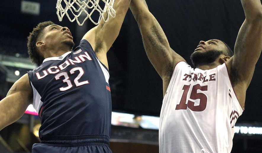 Connecticut forward Shonn Miller (32) puts up a shot in front of Temple forward Jaylen Bond (15) during the first half of an NCAA college basketball game in the semifinals of the American Athletic Conference men's tournament in Orlando, Fla., Saturday, March 12, 2016. (AP Photo/Phelan M. Ebenhack)