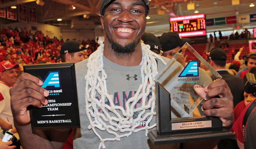 Stony Brook's Jameel Warney celebrates while wearing the net and displaying his MVP trophy celebrate following their 80-74 win over Vermont in an NCAA college basketball game in the championship of the  American East Conference men's tournament, Saturday, March 12, 2016, in Stony Brook, N.Y. (Daniel De Mato/Newsday via AP) NYC OUT, NO SALES