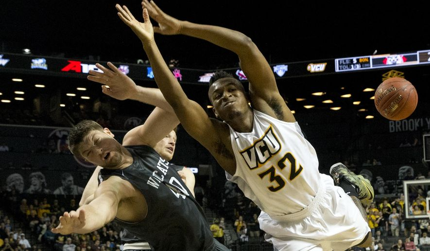 Virginia Commonwealth guard Melvin Johnson (32) and Davidson forward Andrew McAuliffe (40) collide during the first half of an NCAA college basketball game during the semifinals of the Atlantic 10 men's tournament, Saturday, March 12, 2016, in New York. (AP Photo/Mary Altaffer)