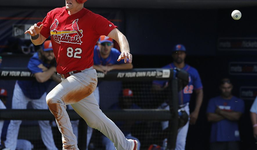 St. Louis Cardinals' Carson Kelly runs for home plate as he beats the ball in to score during the third inning of an exhibition spring training baseball game against the New York Mets, Saturday, March 12, 2016, in Port St. Lucie, Fla. (AP Photo/Brynn Anderson)