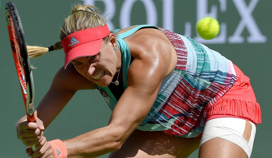 Angelique Kerber, of Germany, returns a volley from Denisa Allertova during their match at the BNP Paribas Open tennis tournament, Saturday, March 12, 2016, in Indian Wells, Calif. (AP Photo/Mark J. Terrill)