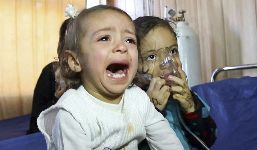 In this Friday, March 11, 2016 photo, young victims exposed to a chemical attack wait for treatment at a hospital in Taza, 10 miles (20 kilometers) south of Kirkuk in northern Iraq. The Islamic State group launched two chemical attacks near the northern Iraqi city of Kirkuk, killing a three-year-old girl, wounding some 600 people and causing hundreds more to flee, Iraqi officials said Saturday. (AP Photo)