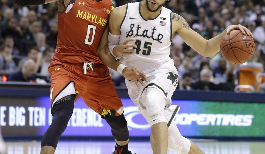 Michigan State guard Denzel Valentine (45) drives on Maryland guard Rasheed Sulaimon (0) in the first half of an NCAA college basketball game during the semifinals of the Big Ten Conference tournament in Indianapolis, Saturday, March 12, 2016. (AP Photo/Michael Conroy)