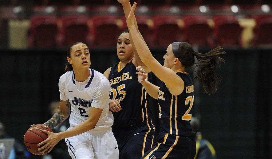 James Madison's Destiny Jones, left, looks to pass under pressure from  Drexel's  Meghan Creighton,, right, and Kelsi Lidge in the first half of an NCAA college basketball game in the championship of the Colonial Athletic Association women's tournament, Saturday, March 12, 2016, in Upper Marlboro, Md. (AP Photo/Gail Burton)