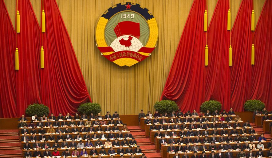 """FILE - In this March 3, 2016, file photo, delegates listen to a speech during the opening session of the Chinese People's Political Consultative Conference at Beijing's Great Hall of the People. China's chief prosecutor Cao Jianmin said in a speech on Sunday, March 13, 2016, battling """"infiltration, subversion and sabotage by hostile forces"""" is a key priority this year, with terrorists, ethnic separatists and religious extremists all in his crosshairs. (AP Photo/Mark Schiefelbein, File)"""
