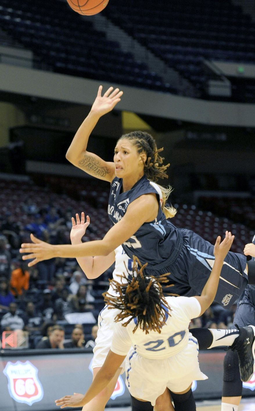 Old Dominion's Jennie Simms (25) jumps over Middle Tennessee's Ty Petty (20) during the first half of the NCAA women's college basketball game in the championship of the Conference USA men's tournament Saturday, March 12, 2016, in Birmingham, Ala. (AP Photo/Eric Schultz)