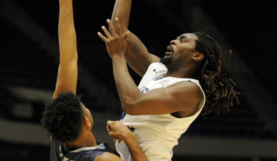Middle Tennessee's Giddy Potts, right, shoots over Old Dominion's Brandan Stith, left, during the first half of an NCAA college basketball game in the championship of the Conference USA men's tournament, Saturday, March 12, 2016, in Birmingham, Ala. (AP Photo/Eric Schultz)