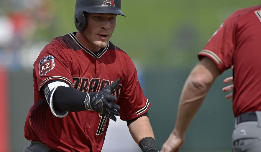 Arizona Diamondbacks' Chris Herrmann is congratulated as he rounds third after hitting a three-run home run in the third inning of an exhibition spring training baseball game against the Kansas City Royals, Friday, March 11, 2016, in Surprise, Ariz. (John Sleezer/The Kansas City Star via AP) MANDATORY CREDIT
