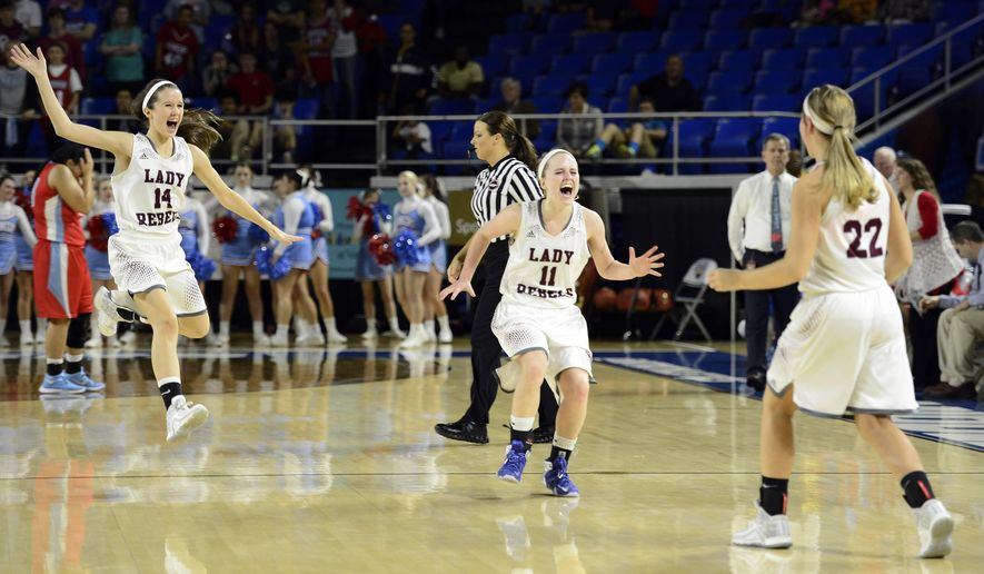 South Greene's Ashlyn Reaves (14), Braelyn Wykle (11) and Morgan Williams (22) celebrate their 61-55 win against Gibson County in the Tennessee Division I A girls high school basketball championship game Saturday, March 12, 2016, in Murfreesboro, Tenn. (AP Photo/Mark Zaleski)