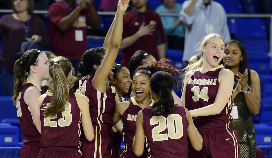 Riverdale players celebrate their 68-36 win against Oak Ridge in the Tennessee Division I AAA girls high school basketball championship game Saturday, March 12, 2016, in Murfreesboro, Tenn. (AP Photo/Mark Zaleski)