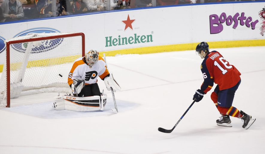 Florida Panthers center Aleksander Barkov (16) gets the puck past Philadelphia Flyers goalie Steve Mason (35) during a shootout in an NHL hockey game, Saturday, March 12, 2016, in Sunrise, Fla.  (AP Photo/Wilfredo Lee)