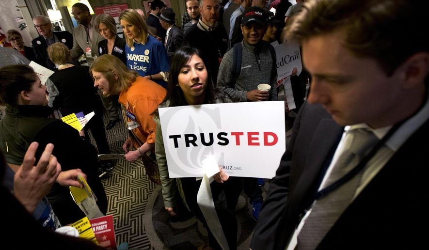 Vinca Puri makes her choice known carrying a placard in support of Republican presidential candidate Sen. Ted Cruz, R-Texas, during the GOP caucus in Washington, Saturday, March 12, 2016. Washington Republicans are voting for 16 allocated delegates to the Republican National Convention.   (AP Photo/Manuel Balce Ceneta)