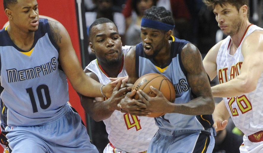 Memphis Grizzlies guard Briante Weber, second from right, tries to fend off Atlanta Hawks forward Paul Millsap (4) and guard Kyle Korver (26) from getting the ball as Jarell Martin (10) assists during the first half of an NBA basketball game, Saturday, March 12, 2016, in Atlanta. (AP Photo/John Amis)