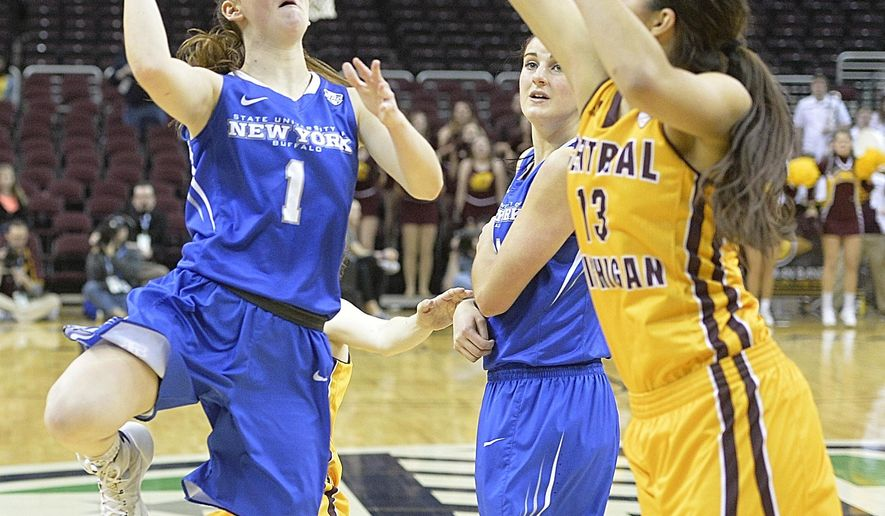 Buffalo's Stephanie Reid drives to the basket while scoring a last-second, game-winning basket in overtime  of an NCAA college basketball game against Central Michigan in the championship of the Mid-American Conference women's tournament, Saturday, March 12, 2016, in Cleveland. Buffalo won 73-71 in overtime. (AP Photo/Dave Richard