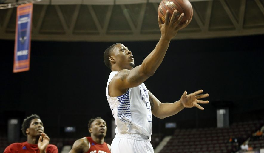 Hampton's Reginald Johnson Jr. goes to the basket during the first half of an NCAA college basketball game against South Carolina State in the championship of the Mid-Eastern Athletic Conference men's tournament in Norfolk, Va., Saturday, March 12, 2016. (AP Photo/Chet Strange)