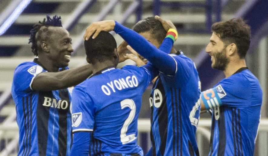 Montreal Impact's Dominic Oduro, left, celebrates with teammates after scoring against the New York Red Bulls during the second half of an MLS soccer match in Montreal Saturday, March 12, 2016. (Graham Hughes /The Canadian Press via AP) MANDATORY CREDIT