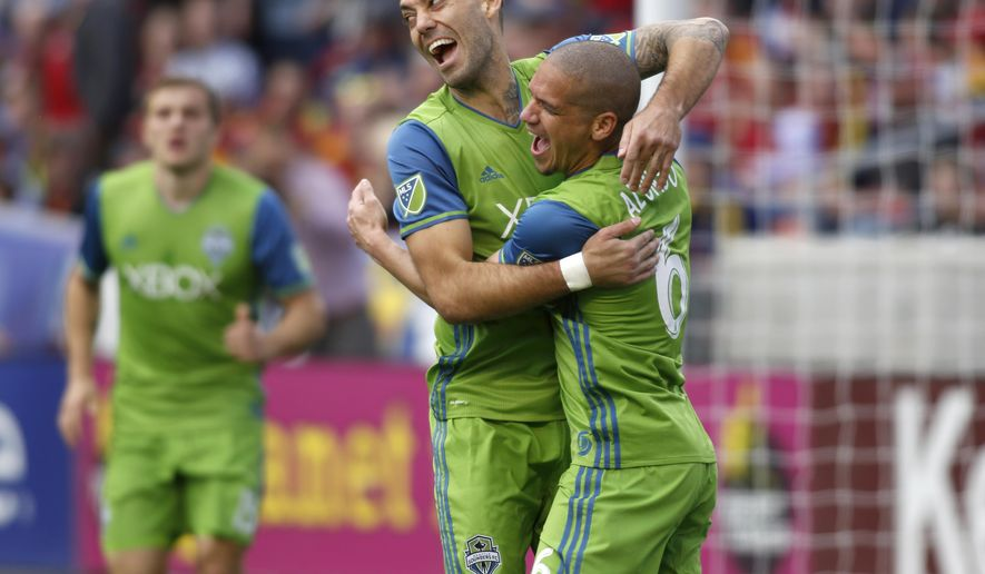 Seattle Sounders' Osvaldo Alonso (6) celebrates after scoring a goal with Seattle Sounders' Clint Dempsey during the first half of an MLS soccer game against Real Salt Lake on Saturday, March 12, 2016, in Sandy, Utah. (AP Photo/Kim Raff)