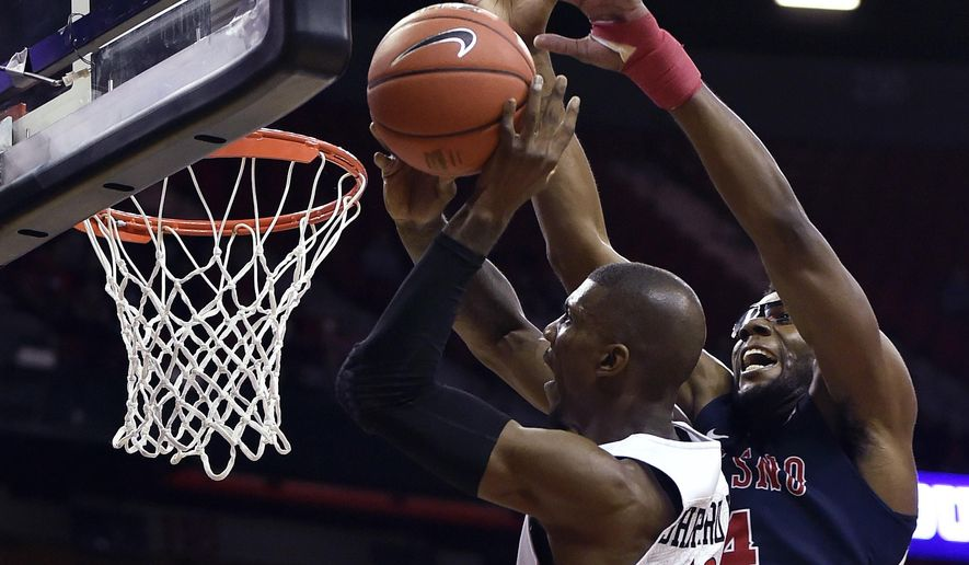 San Diego State's Winston Shepard (13) shoots against Fresno State's Karachi Edo during the first half of an NCAA college basketball game in the finals of the Mountain West Conference men's tournament Saturday, March 12, 2016, in Las Vegas. (AP Photo/David Becker)