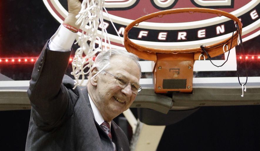 FILE - In this March 5, 2016, file photo, Austin Peay head coach Dave Loos cuts down the net afterdefeating UT Martin in an NCAA college basketball game at the championship of the Ohio Valley Conference basketball tournament in Nashville, Tenn.  Loos coached his Austin Peay Governors to four wins in as many days to earn the program's first OVC tournament title and NCAA Tournament berth since 2008. The timing could not have been more perfect coming on Loos' 69th birthday with his granddaughter Rhyan watching on TV after surgery for a rare form of pediatric cancer. (AP Photo/Mark Humphrey, File)