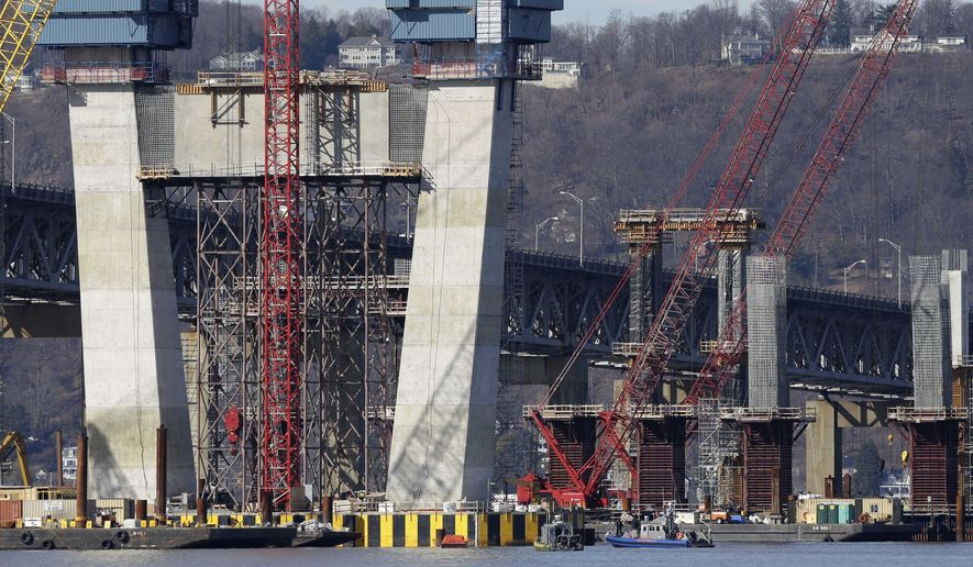 Boats of emergency officials work near the site of a fatal collision in the water underneath the Tappan Zee Bridge in Tarrytown, N.Y., Saturday, March 12, 2016.   A tugboat crashed into a barge on the Hudson River north of New York City early Saturday killing at least one crew member and leaving two still missing. (AP Photo/Seth Wenig)