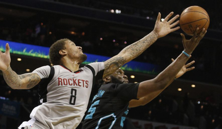 Houston Rockets' Michael Beasley (8) battles Charlotte Hornets' Al Jefferson (25) for a loose ball during the first half of an NBA basketball game in Charlotte, N.C., Saturday, March 12, 2016. (AP Photo/Bob Leverone)