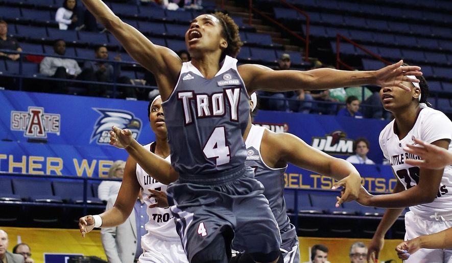 Troy guard Ashley Beverly-Kelley (4) goes up for a shot against Arkansas Little Rock forward Shanity James, left, and Arkansas Little Rock guard Monique Townson, right, in the first half of an NCAA college basketball game in the championship of the Sun Belt Conference women's tournament in New Orleans, Saturday, March 12, 2016.  (AP Photo/Max Becherer)