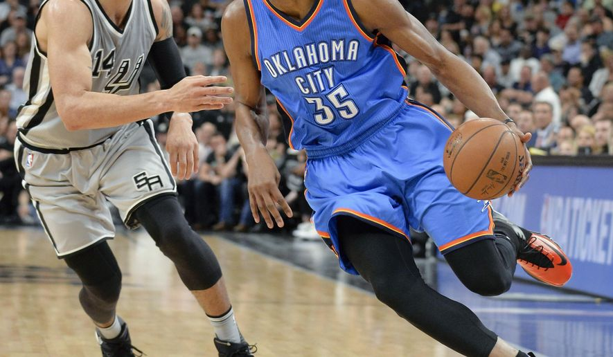 Oklahoma City Thunder forward Kevin Durant (35) drives around San Antonio Spurs guard Danny Green during the first half of an NBA basketball game Saturday, March 12, 2016, in San Antonio. (AP Photo/Darren Abate)