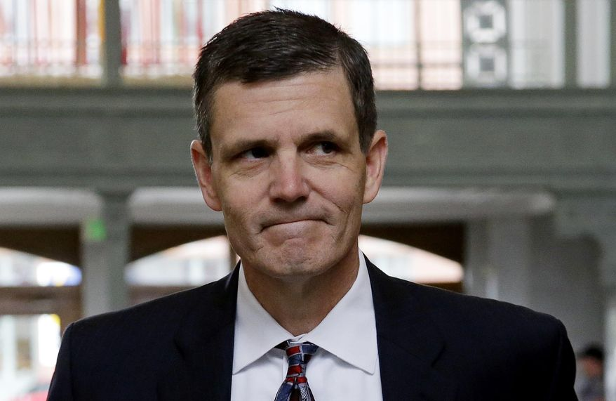 FILE -- In this June 12, 2015, file photo, Washington Auditor Troy Kelley walks into the federal courthouse for a hearing on tax evasion charges he faces, in Tacoma, Wash. Kelley, the first Washington state official indicted in more than three decades, faces a federal trial Monday, March 14, 2016, with hopes of persuading a jury that the $1.4 million he's accused of stealing wasn't actually stolen. (AP Photo/Elaine Thompson, File)