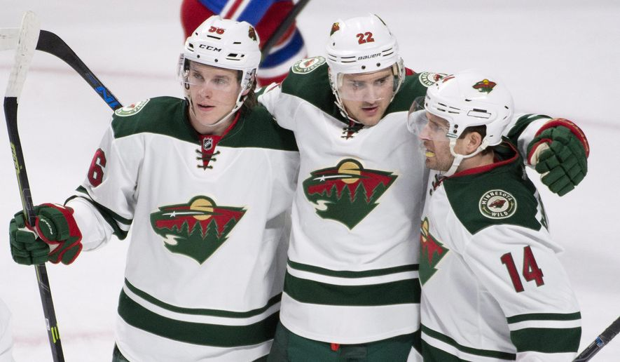 Minnesota Wild's Nino Niederreiter (22) celebrates with teammates Erik Haula (56) and Justin Fontaine (14) after scoring against the Montreal Canadiens during the first period of an NHL hockey game in Montreal on Saturday, March 12, 2016. (Graham Hughes /The Canadian Press via AP) MANDATORY CREDIT