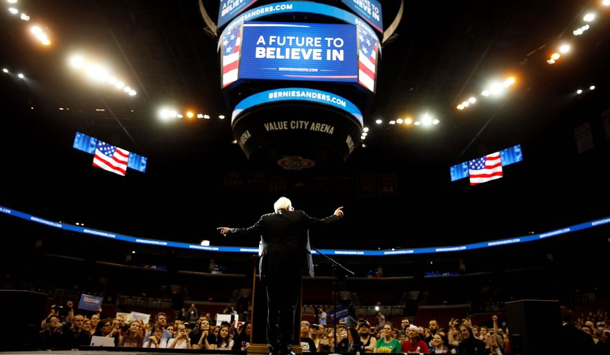 Democratic presidential candidate Bernard Sanders told a raucous crowd at Ohio State University on Sunday that the nation's trade deals are hurting American workers. (Associated Press)