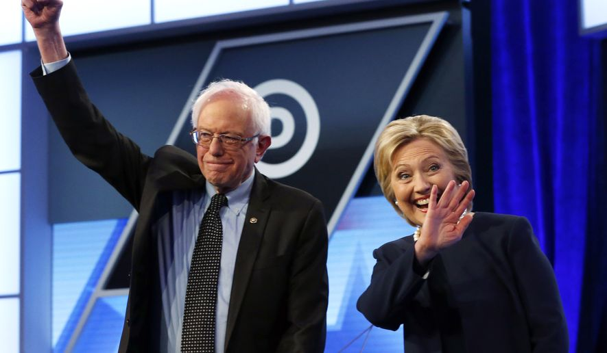 Democratic presidential candidates Hillary Clinton and Sen. Bernie Sanders, Vermont independent, stand together before the start of the Univision/Washington Post Democratic presidential debate at Miami-Dade College in Miami on March 9, 2016. (Associated Press) **FILE**