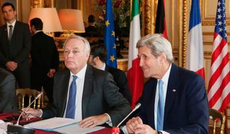French Foreign Minister Jean Marc Ayrault, left, and United States Secretary of State John Kerry, attend a meeting at the Quai d'Orsay ministry in Paris, Sunday, March 13, 2016. U.S. Secretary of State John Kerry is meeting with new French Foreign Minister Jean-Marc Ayrault and Europe's top diplomats to discuss major international issues including the Syria peace talks. (Gonzalo Fuentes/Pool Photo via AP)